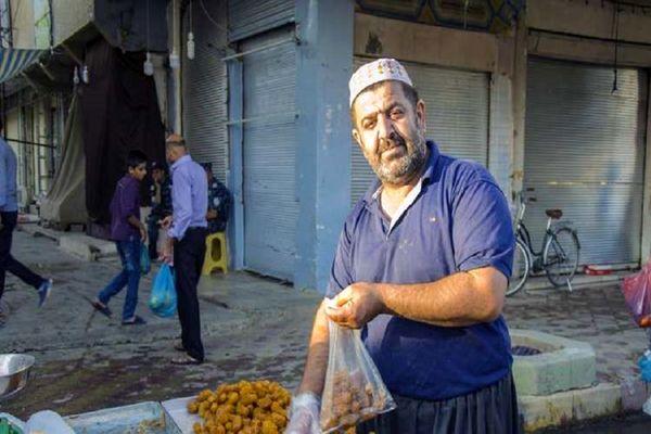 دست فروشی که نماینده پارلمان شد+عکس